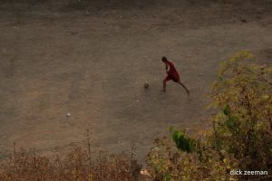 Monk playing football